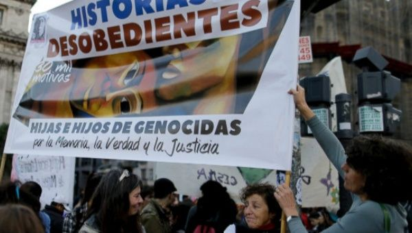 "In this June 3, 2017 photo, Liliana Furio, second from right, holds a banner reading ""Disobedient Stories"" during a protest in Buenos Aires, Argentina."