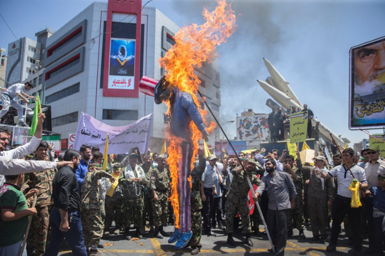 A scarecrow model is set on fire by Iranian demonstratorson during the annual pro-Palestinian rally marking Al-Quds Day in Tehran, Iran, June 23, 2017.