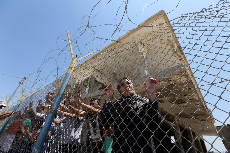 Meanwhile, Palestinians gather in front of the gate of Rafah border crossing between Egypt and Gaza during a protest against the blockade calling for reopening of the crossing, in the southern Gaza Strip July 3, 2017.