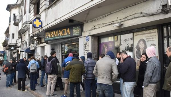 People line up in the early morning in Montevideo to buy marijuana.