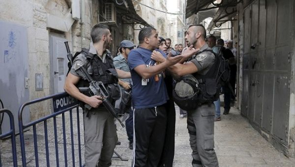 Israeli forces detain a man in occupied East Jerusalem