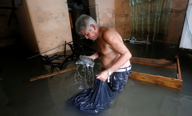 People have to sort through their drenched belongings after their homes were flooded in Havana