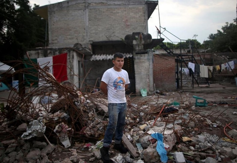 "Rene Contreras, 20, a student, whose house was badly damaged, said: ""Now I live with my brother. Tomorrow a good hearted person will build for me an emergency house. I will fight to get ahead."""