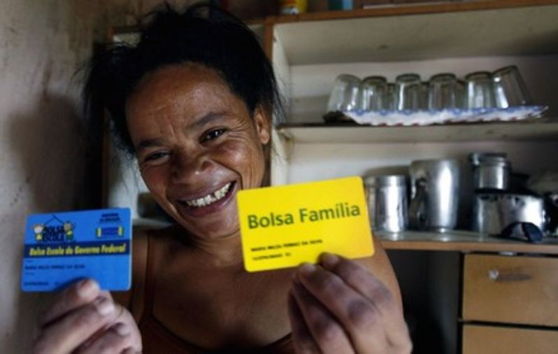 Maria Nilza, a Brazilian mother of four, shows her bolsa familia cards.