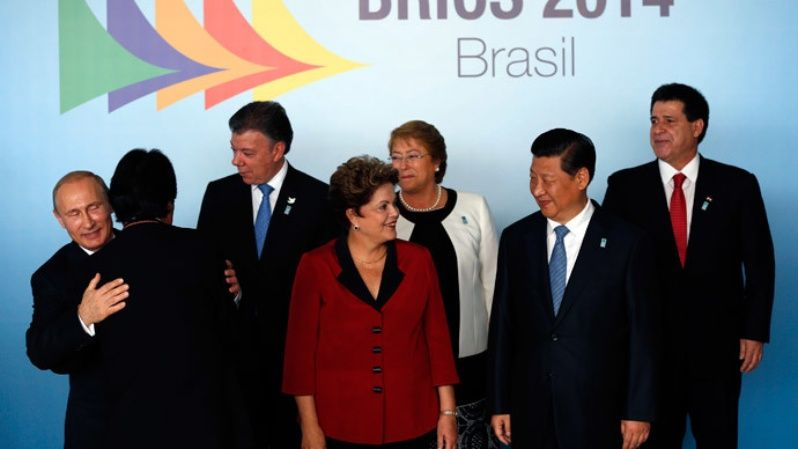 Russia's President Vladimir Putin (L-R), Bolivia's President Evo Morales, Colombia's President Juan Manuel Santos, Brazil's President Dilma Rousseff, Chile's President Michelle Bachelet, China's President Xi Jinping and Paraguayan President Horacio Cartes talk at a group photo session during the 6th BRICS summit and the Union of South American Nations (UNASUR) in Brasilia July 16, 2014.