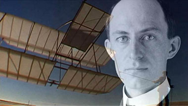 Wilbur Wright and a replica 1900 glider flown as a kite.