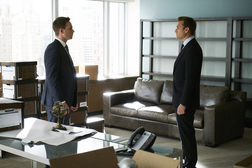 """SUITS -- """"Skin In the Game"""" Episode 701 -- Pictured: (l-r) Patrick J. Adams as Michael Ross, Gabriel Macht as Harvey Specter -- (Photo by: Ian Watson/USA Network)"""