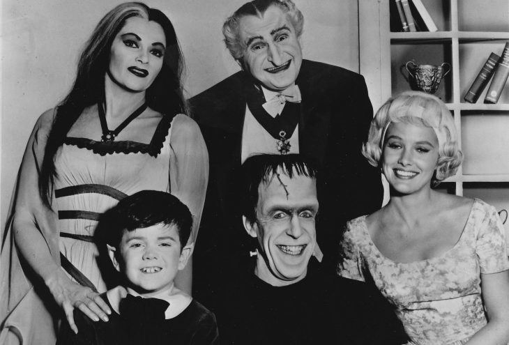 Publicity photo of television actors, (sitting; L–R) Butch Patrick, Fred Gwynne, Beverley Owen, (standing; L–R) Yvonne De Carlo and Al Lewis promoting their roles on the CBS comedy series The Munsters.