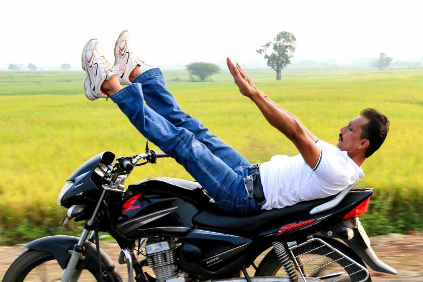 High Octane Yoga: Indian Man Pulls Yoga Poses On Speeding Motorbike