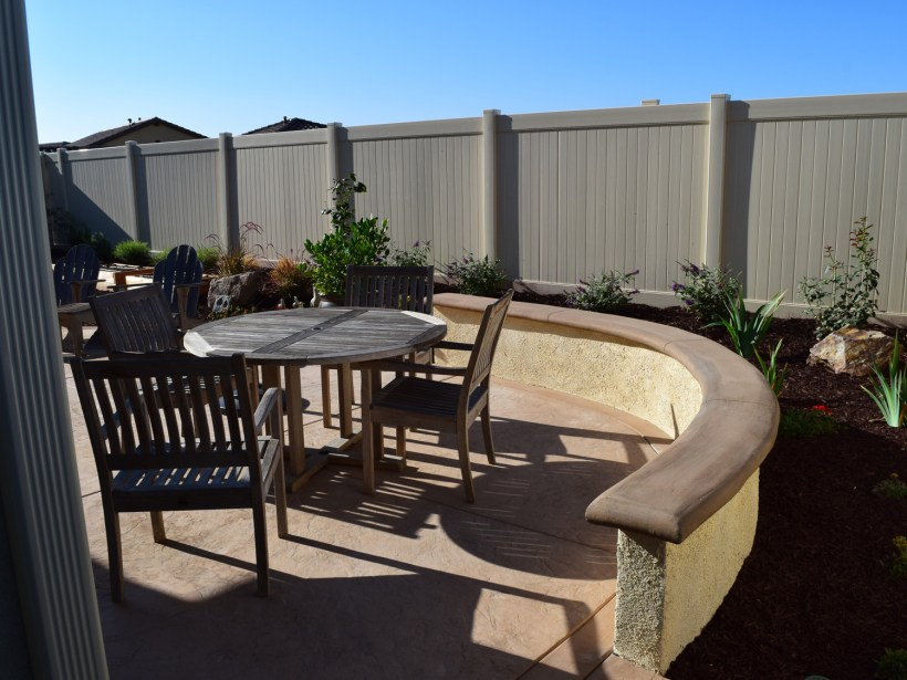 Sitting wall with colored concrete patio in Temecula McCabe's Landscape Construction
