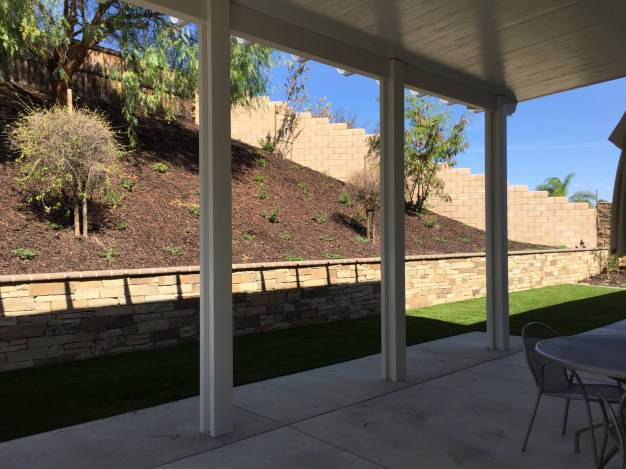 Patio cover with stone faced wall in Temecula McCabe's Landscape Construction