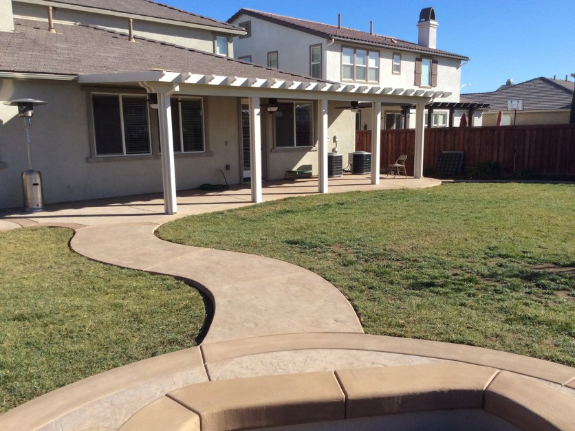 Alumawood patio cover and colored concrete in Menifee McCabe's Landscape Construction
