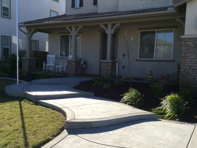 McCabe's Landscape Construction Grey Concrete front steps in Mennifee