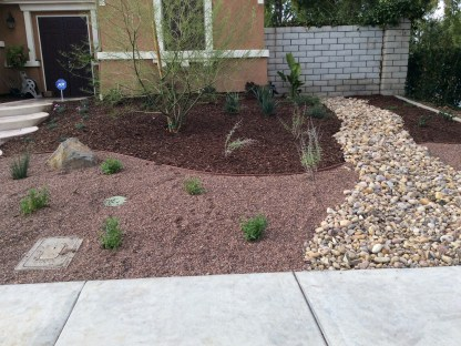 Gravel front yard with dry river bed in Murrieta McCabe's Landscape Construction