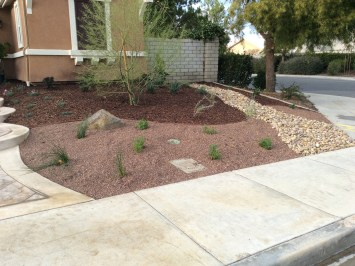Dry River bed with gravel front yard in Murrieta McCabe's Landscape Construction