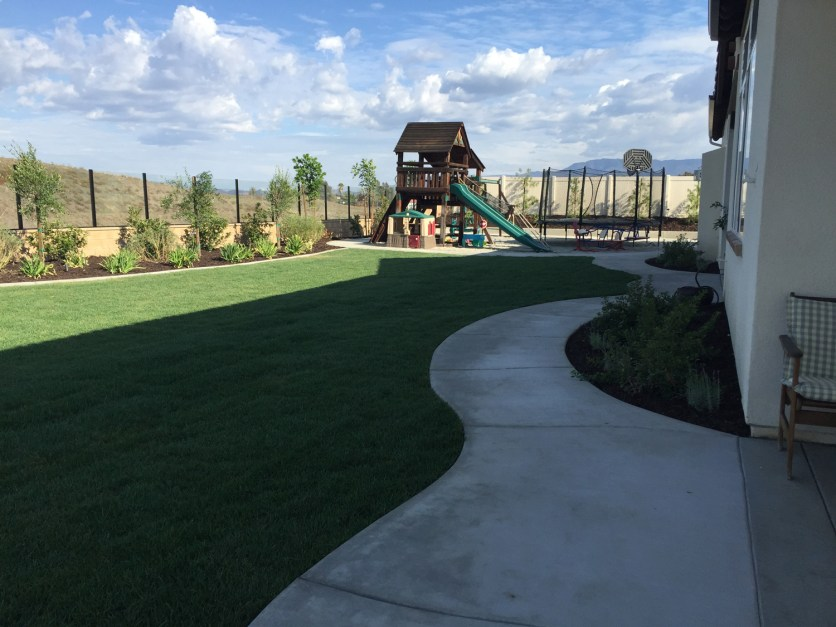 Rear grass with playground in Temecula McCabe's Landscape Construction
