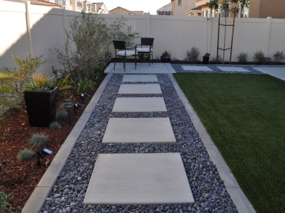 Modern concrete squares with Mexican beach pebbles in Temecula McCabe's Landscape Construction