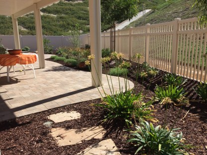 Paver patio with alumawood patio cover in Winchester McCabe's Landscape Construction