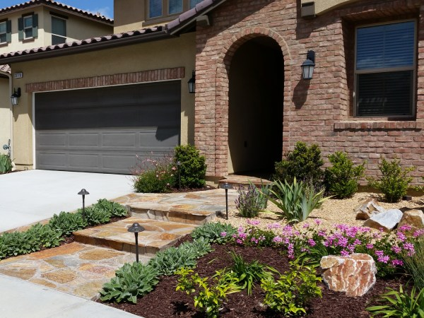 mediterranean front yard with flagstone