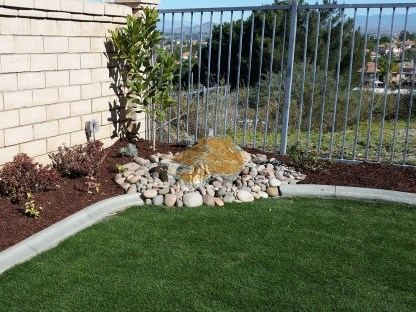 Custom boulder water feature