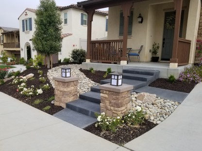 Front steps, pilasters, dry river bed