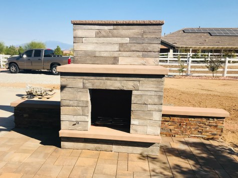 Wood faced outdoor fireplace