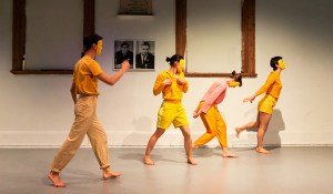 Dancers in the space wearing yellow