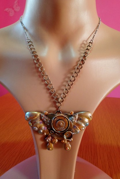Butterfly and real cog pendant