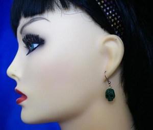 Green 3D skull earrings