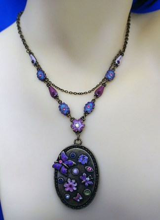 Fantasy butterfly and flower cameo necklace