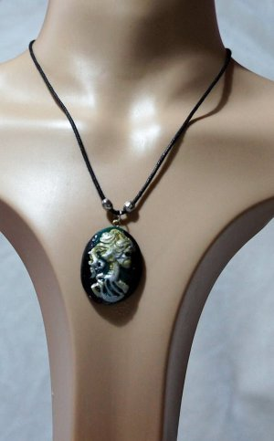 Green and black skeleton lady cameo necklace