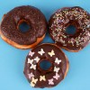 Three donuts on blue background