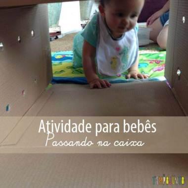 Atividade para bebês com caixa de papelão e bolas