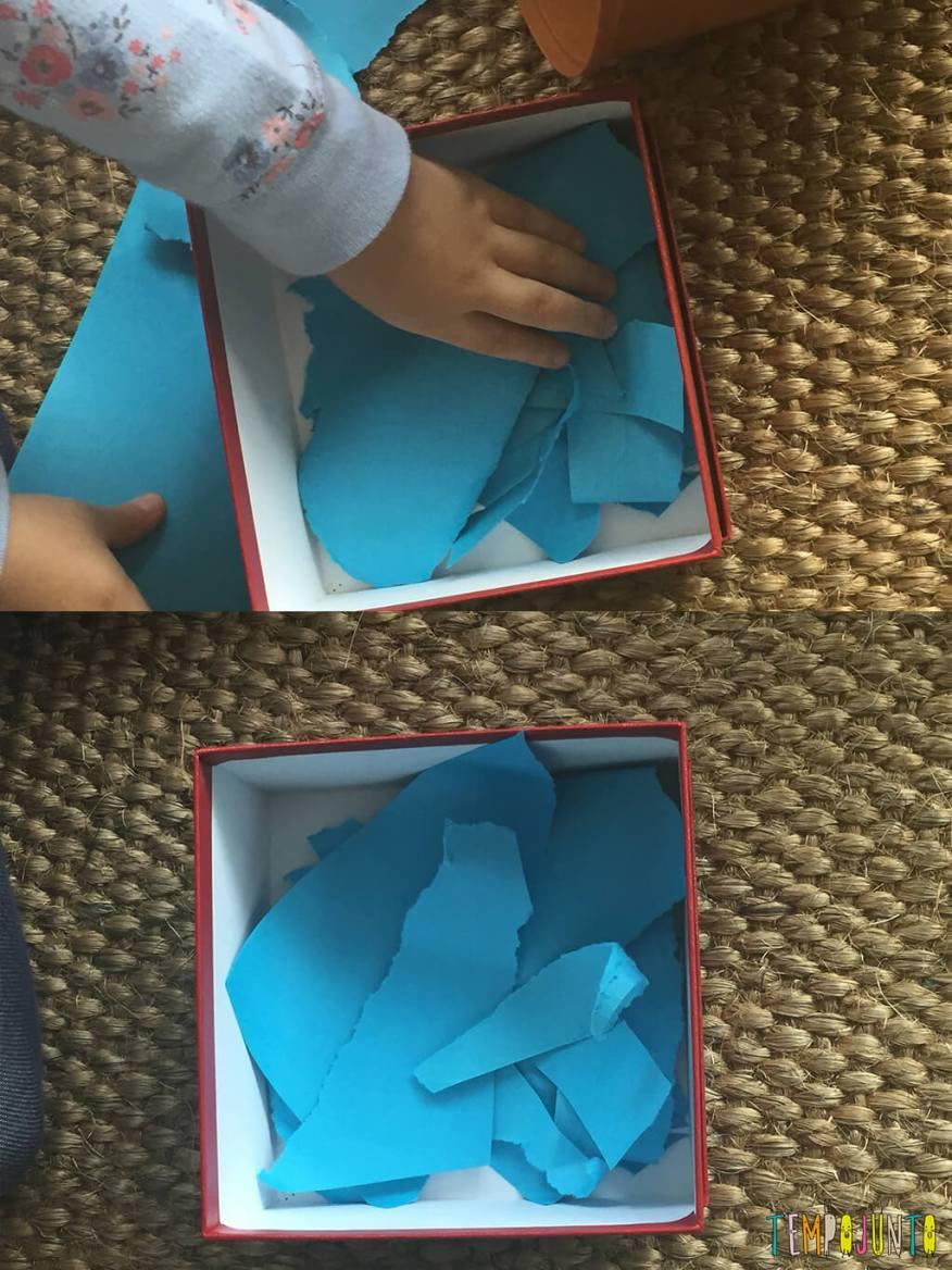 Brincadeira de recortar que incentiva o imaginar - gabi colocando o papel na caixa