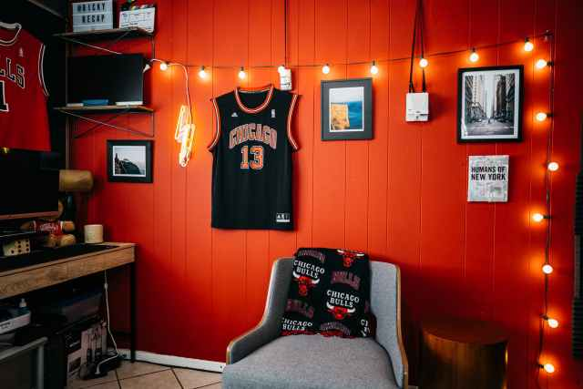 black and white jersey shirt on red wall