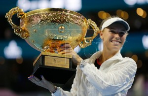 Caroline Wozniacki of Denmark poses with her trophy after winning the women's singles final match against Anastasija Sevastova of Latvia at the China Open tennis tournament in Beijing, China, 07 October 2018. EPA-EFE/WU HONG