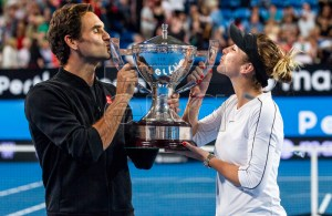 Roger Federer and Belinda Bencic of Switzerland hold up the Hopman Cup after winning the mixed doubles match between Switzerland and Germany on day 8 of the Hopman Cup tennis tournament at RAC Arena in Perth, Australia, 05 January 2019. EPA-EFE/TONY MCDONOUGH AUSTRALIA AND NEW ZEALAND OUT EDITORIAL USE ONLY EDITORIAL USE ONLY