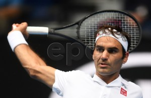 Roger Federer of Switzerland in action against Daniel Evans of Britain during their second round men's singles match at the Australian Open Grand Slam tennis tournament in Melbourne, Australia, 16 January 2019. EPA-EFE/LUKAS COCH AUSTRALIA AND NEW ZEALAND OUT