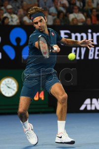 Roger Federer of Switzerland in action during his men's singles fourth round match against Stefanos Tsitsipas of Greece at the Australian Open Grand Slam tennis tournament in Melbourne, Australia, 20 January 2019. EPA-EFE/LUKAS COCH AUSTRALIA AND NEW ZEALAND OUT