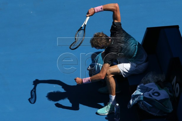 Alexander Zverev of Germany smashes his racquet during a break in action against Milos Raonic of Canada during their round four men's singles match at the Australian Open Grand Slam tennis tournament in Melbourne, Australia, 21 January 2019. EPA-EFE/HAMISH BLAIR AUSTRALIA AND NEW ZEALAND OUT