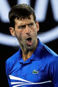 Novak Djokovic of Serbia reacts during his men's singles semi final match against Lucas Pouille of France at the Australian Open Grand Slam tennis tournament in Melbourne, Australia, 25 January 2019.  EPA-EFE/MAST IRHAM