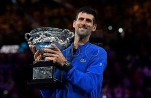Novak Djokovic of Serbia raises the trophy after winning his men's singles final match against Rafael Nadal of Spain at the Australian Open Grand Slam tennis tournament in Melbourne, Australia, 27 January 2019. EPA-EFE/JULIAN SMITH EDITORIAL USE ONLY AUSTRALIA AND NEW ZEALAND OUT