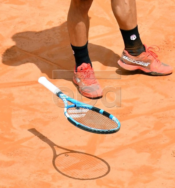 Fabio Fognini of Italy throws his racket during his men's singles second round match against Dominic Thiem of Austria at the Italian Open tennis tournament in Rome, Italy, 16 May 2018.  EPA-EFE/ETTORE FERRARI