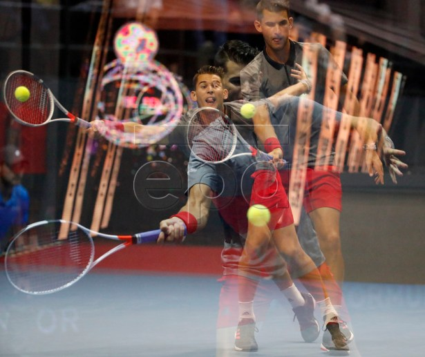 A multiple exposure picture of Austria's Dominic Thiem in action during the singles final match against Martin Klizan of Slovakia at the St.Petersburg Open ATP tennis tournament in St.Petersburg, Russia, 23 September 2018.  EPA-EFE/ANATOLY MALTSEV