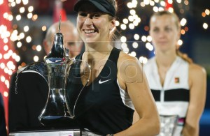 Belinda Bencic (L) of Switzerland celebrates with trophy after winning her final match against Petra Kvitova (R) of the Czech Republic at Dubai Duty Free Tennis WTA Championships 2019 in Dubai, United Arab Emirates, 23 February 2019. EPA-EFE/ALI HAIDER