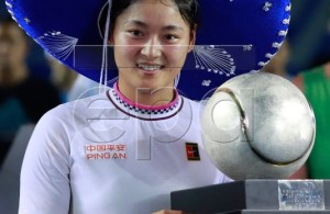 Wang Yafan of China celebrates with her trophy after defeating Sofia Kenin of the USA during their women's final match at the Mexican Open tennis tournament in Acapulco, Mexico, 02 March 2019. EPA-EFE/DAVID GUZMAN