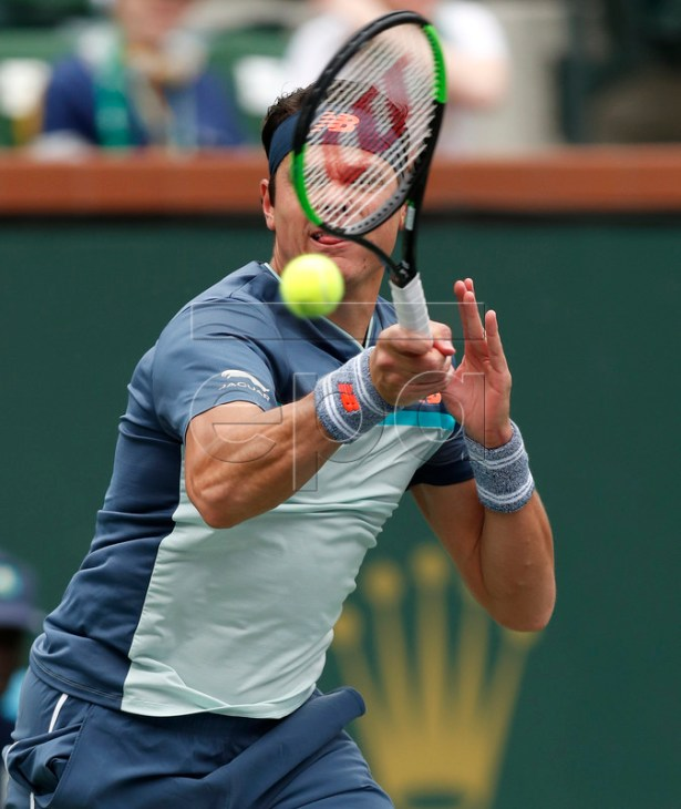 Milos Raonic of Canada in action against Marcos Giron of the US during the BNP Paribas Open tennis tournament at the Indian Wells Tennis Garden in Indian Wells, California, USA, 11 March 2019. The men's and women's final will be played, 17 March 2019.  EPA-EFE/JOHN G. MABANGLO