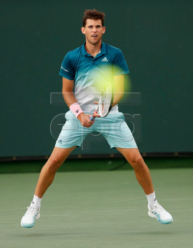 Dominic Thiem of Austria in action against Gilles Simon of France during the BNP Paribas Open tennis tournament at the Indian Wells Tennis Garden in Indian Wells, California, USA, 11 March 2019. The men's and women's final will be played, 17 March 2019.  EPA-EFE/JOHN G. MABANGLO