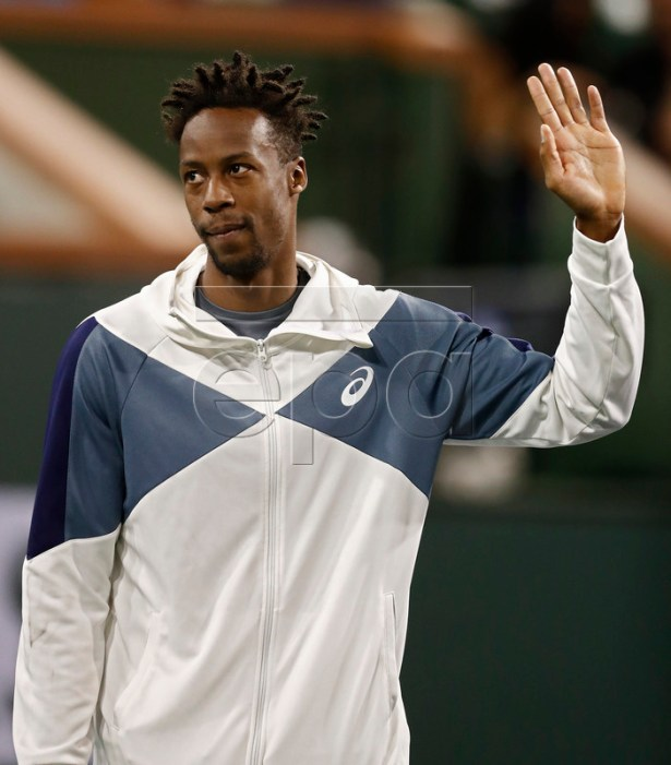 Gael Monfils of France waves to the crowd after he announces he has to withdraw due to an injury before his match against Dominic Thiem of Austria during the BNP Paribas Open tennis tournament at the Indian Wells Tennis Garden in Indian Wells, California, USA, 14 March 2019.  EPA-EFE/LARRY W. SMITH