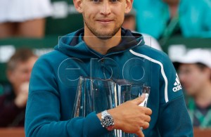 Dominic Thiem of Austria poses with his trophy after defeating Roger Federer of Switzerland during the BNP Paribas Open tennis tournament at the Indian Wells Tennis Garden in Indian Wells, California, USA, 17 March 2019. EPA-EFE/JOHN G. MABANGLO